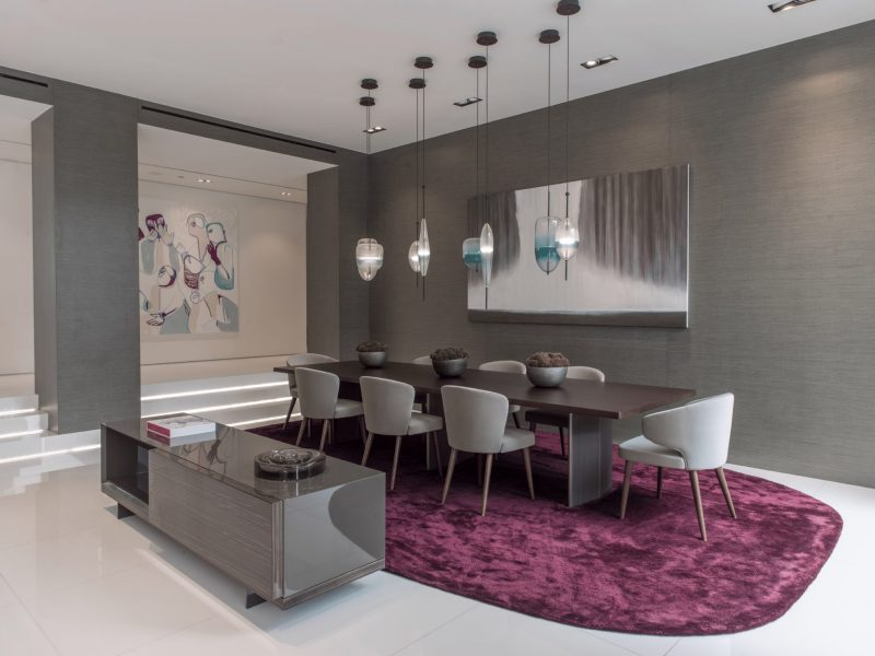 modern dining room with waterfall painting on wall
